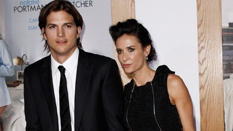 Ashton Kutcher and Demi Moore arrive at the premiere 'No Strings Attached' in Los Angeles, on Tuesday, Jan. 11, 2011. (AP / Matt Sayles)