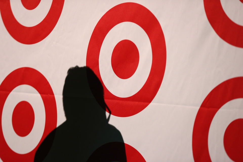 The shadow of Target Canada's John Morioka is cast on a company-branded backdrop, as the chain shows off its brands and design partners at a showcase in Toronto in this January 2013 file photo. (Chris Young/THE CANADIAN PRESS)