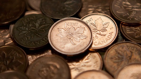 Canadian one cent coins are seen piled in Ottawa, Tuesday December 14, 2010. (THE CANADIAN PRESS/Adrian Wyld)