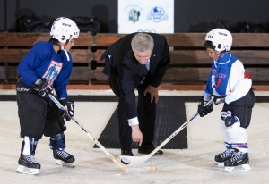 Prime Minister Stephen Harper drops the puck for a hockey scrimmage in this 2011 file photo. (Adrian Wyld/THE CANADIAN PRESS)