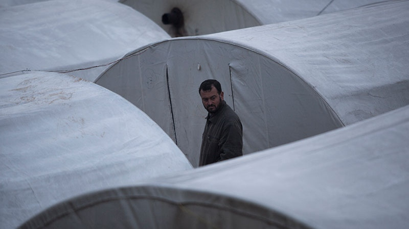 A displaced Syrian man is seen in the Azaz camp for displaced people, north of Aleppo province, Syria, Friday, Feb. 22, 2013. (AP / Manu Brabo)