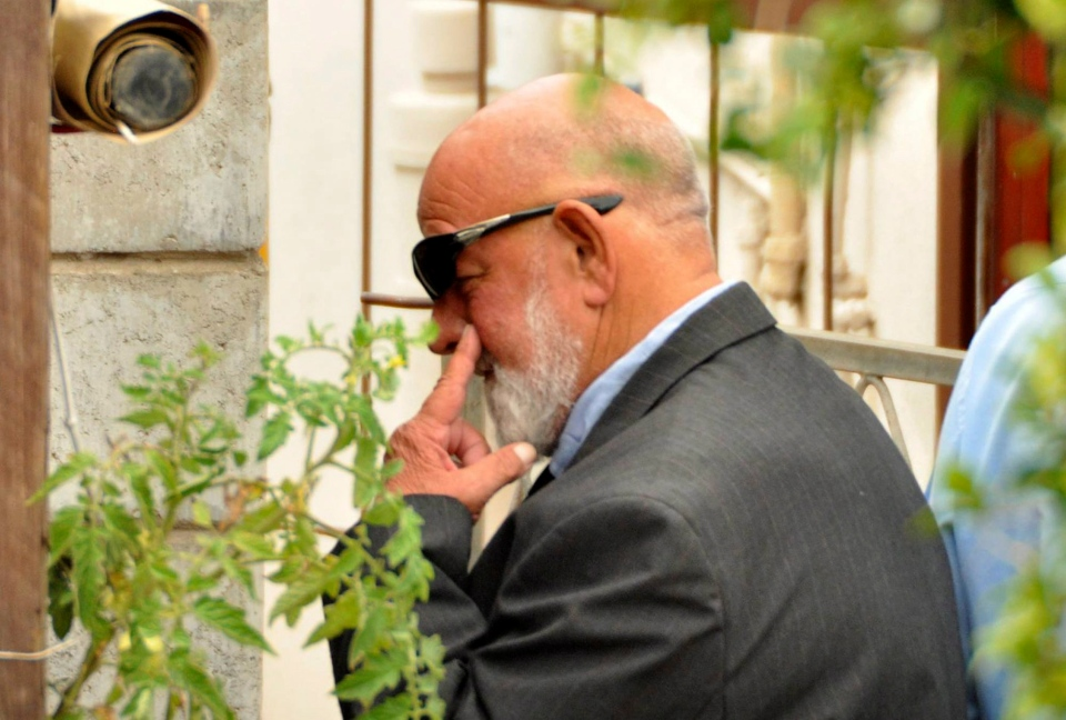 Barry Steenkamp, the father of Reeva Steenkamp, leaves his home to attend her funeral ceremony in Port Elizabeth, South Africa, Tuesday, Feb. 19, 2013. (AP / Schalk van Zuydam)