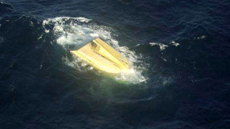 The capsized fishing boat Miss Ally is shown in an undated Canadian Forces handout photo.