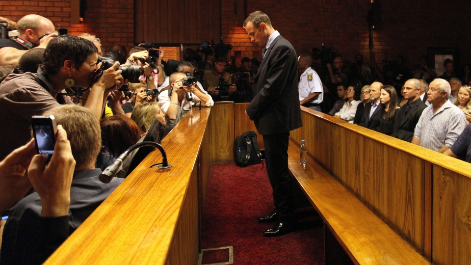 Olympic athlete Oscar Pistorius stands in the dock during his bail hearing at the magistrates court in Pretoria, South Africa, Friday, Feb. 22, 2013. (AP / Themba Hadebe)