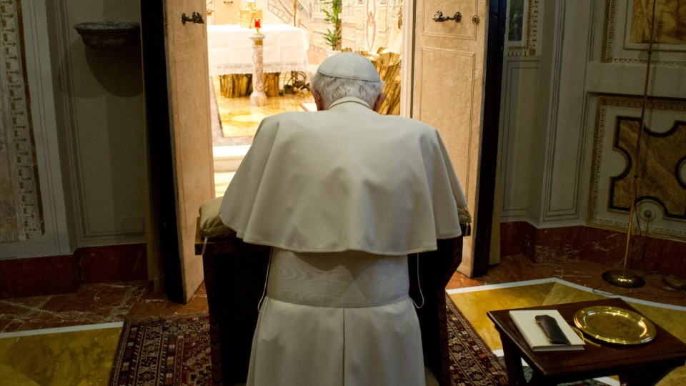 Pope Benedict XVI kneels in prayer at the end of a week-long spiritual retreat, at the Vatican, Saturday, Feb. 23, 2013. (L'Osservatore Romano)