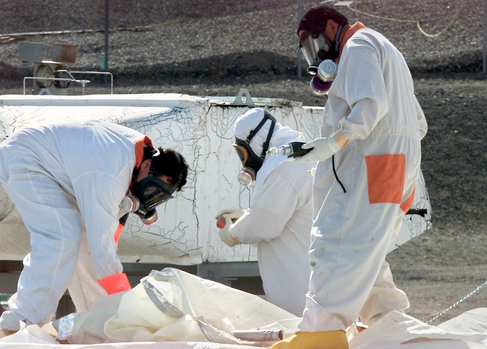 Workers measure for radiation and the presence of toxic vapors at the tank farms on the Hanford Nuclear Reservation near Richland, Wash., March 23, 2004. (AP / Jackie Johnston)