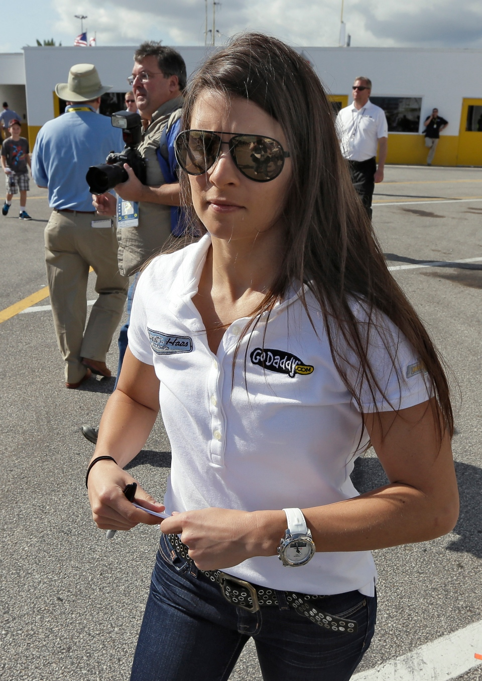 Daytona 500 pole sitter Danica Patrick walks through the garage area during a NASCAR Sprint Cup Series auto racing practice at the Daytona International Speedway in Daytona Beach, Fla., Saturday, Feb. 23, 2013. (AP / Chris O'Meara)