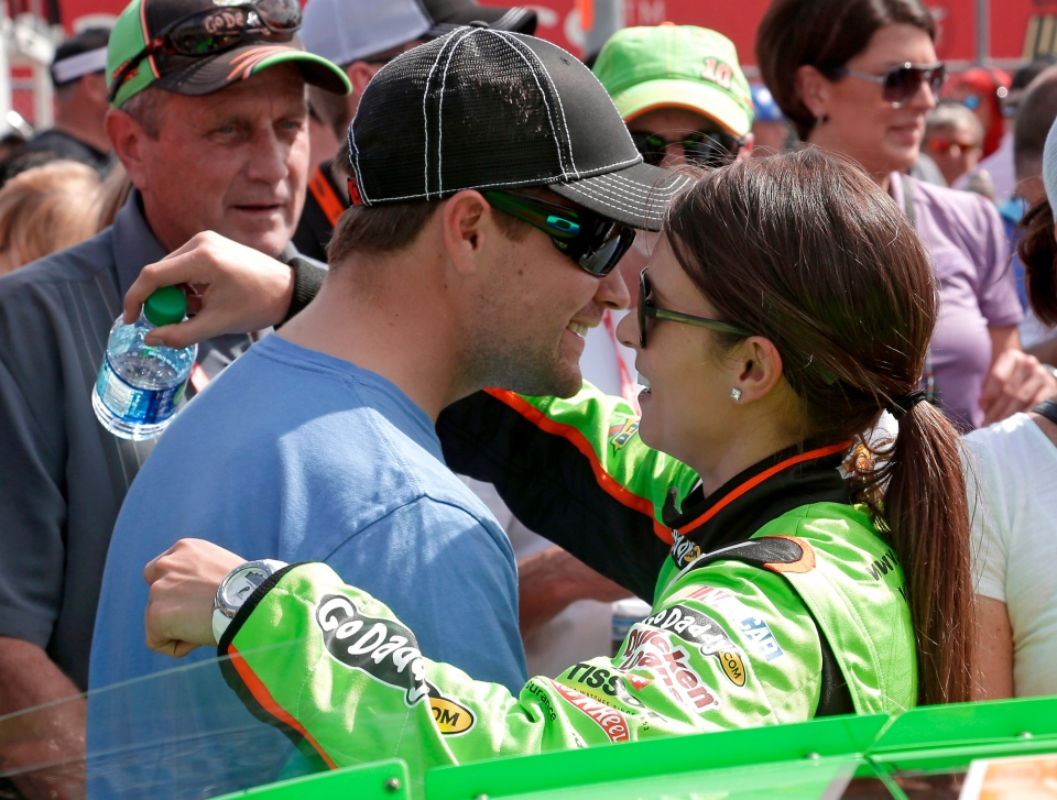Ricky Stenhouse Jr., left, hugs his girlfriend Danica Patrick before her start in the NASCAR Nationwide Series auto race at Daytona International Speedway in Daytona Beach, Fla., Saturday, Feb. 23, 2013. (AP / Chris O'Meara)