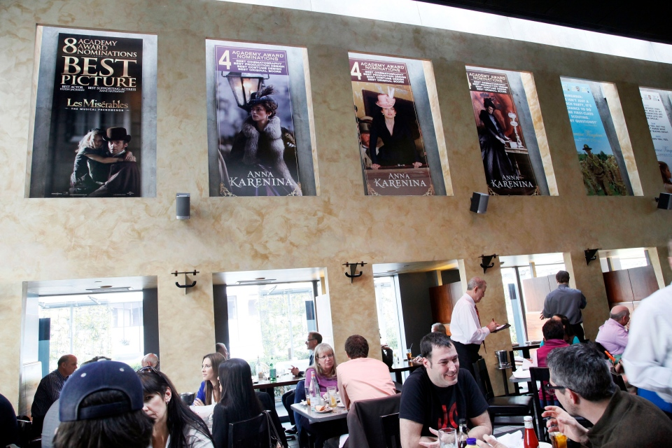 People dine beneath Oscar posters at Kate Mantilini restaurant in Beverly Hills, Calif. (AP / Nick Ut)