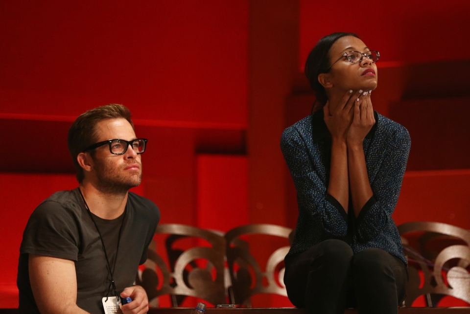 Actors Chris Pine, left, and Zoe Saldana watch rehearsals for the 85th Academy Awards in Los Angeles, Saturday, Feb. 23, 2013. (Invision / Matt Sayles)