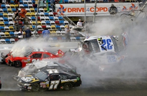 Kyle Larson (32) is airborne after a multi-car crash, including Parker Kilgerman (77), Justin Allgaier (31) and Brian Scott (2) during the final lap of the NASCAR Nationwide Series auto race at Daytona International Speedway in Daytona Beach, Fla., Saturday, Feb. 23, 2013. (AP / John Raoux)