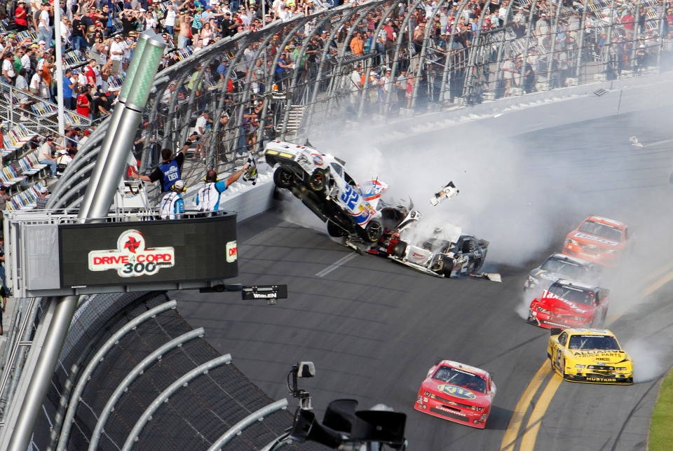 Kyle Larson's car (32) gets airborne during a multi-car wreck on the final lap of the NASCAR Nationwide Series auto race at Daytona International Speedway in Daytona Beach, Fla., on Saturday, Feb. 23, 2013. (AP / David Graham)