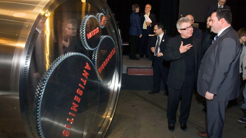 Architech Daniel Libeskind shows Immigration Minister Jason Kenney, right, his sculpture called the Wheel of Conscience, at Pier 21 in Halifax on Thursday, Jan. 20, 2011. (Andrew Vaughan / THE CANADIAN PRESS)
