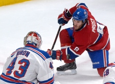 Montreal Canadiens' Brandon Prust, right, takes a
