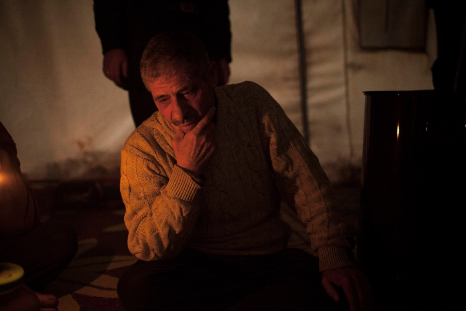A displaced Syrian is seen at his tent in the Azaz camp for displaced people, north of Aleppo province, Syria, Friday, Feb. 22, 2013. (AP / Manu Brabo)