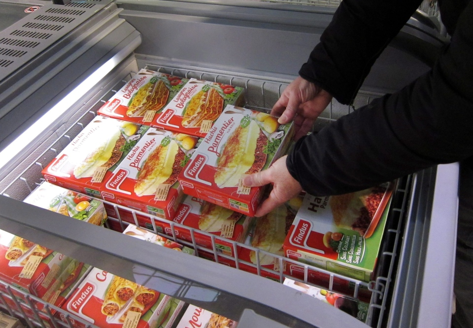 A customer takes a pack of frozen beef Hachis Parmentier from a freezer in a supermarket in Nice, southeastern France, Feb. 11, 2013. (AP / Lionel Cironneau)