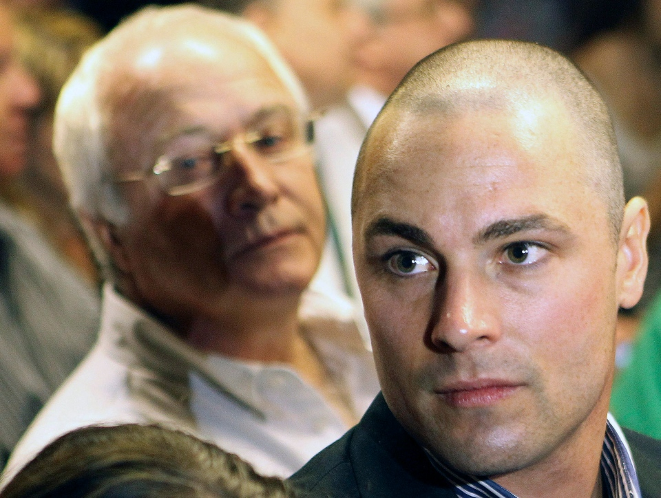 Carl Pistorius, right, and Henke Pistorius, the brother and father of Olympic athlete Oscar Pistorius, attend Oscar's bail hearing at the magistrate court in Pretoria, South Africa, Feb. 19, 2013. (AP / Themba Hadebe)
