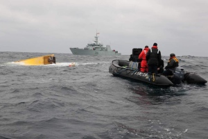 Members of Joint Task Force Atlantic, including navy divers, on scene of Miss Ally. Underwater search confirms no bodies were found in the debris of the fishing boat. (DND Photo)