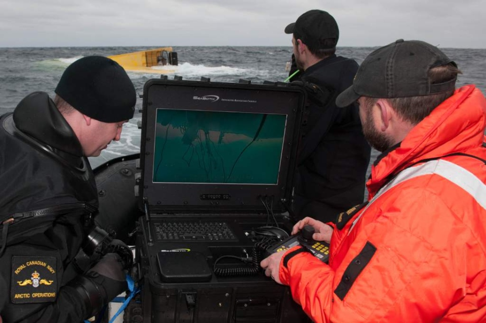 Members of Joint Task Force Atlantic, including navy divers, using sonar to inspect the hull of Miss Ally. Underwater search confirms no bodies were found in the debris of the fishing boat. (DND Photo)