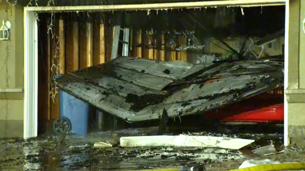 The remains of a detached garage following a fatal house fire in the community of Evergreen