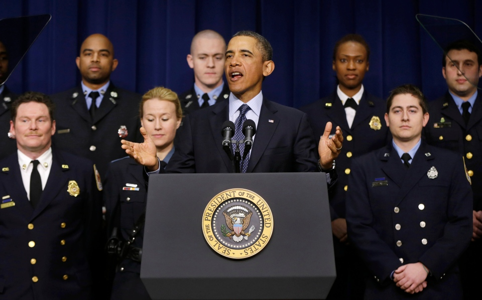 In this Feb. 19, 2013 file photo President Barack Obama talks about sequestration in the Eisenhower Executive Office building on the White House complex in Washington, accompanied on stage by emergency responders, a group of workers the White House says could be affected if state and local governments lose federal money as a result of budget cuts. (AP / Charles Dharapak)
