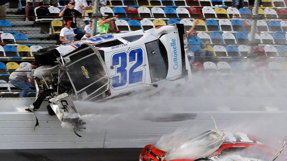 Kyle Larson (32) goes airborne and into the catch fence during a multi-car crash involving Justin Allgaier (31), Brian Scott (2) and others during the final lap of the NASCAR Nationwide Series auto race at Daytona International Speedway in Daytona, Fl., Saturday, Feb. 23, 2013. (AP / John Raoux)