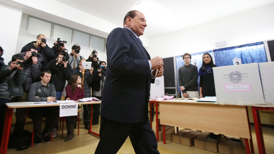 Former Premier Silvio Berlusconi casts his ballot in Milan, Italy, Sunday, Feb. 24, 2013. (AP / Antonio Calanni)