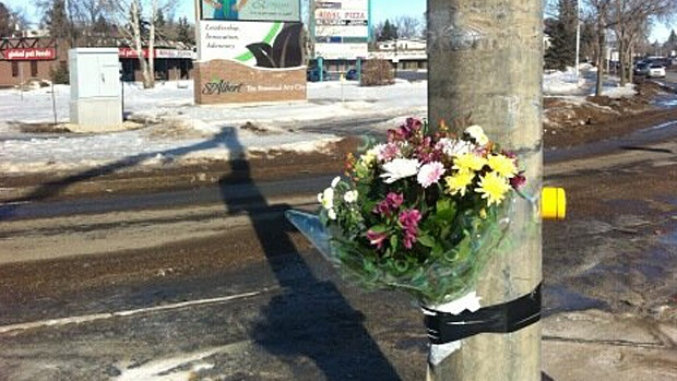 Flowers have been left at an intersection in St. Albert where a 20-year-old man was killed Saturday night.