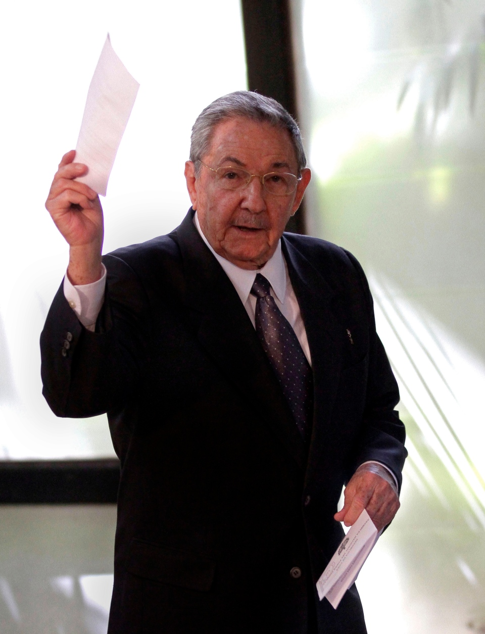 Cuba's President Raul Castro holds up the ballot of his brother Fidel, also present in the session, for president of the National Assembly during the opening session of the parliament in Havana, Cuba, Sunday, Feb. 24, 2012. (AP / Ismael Francisco, Cubadebate)