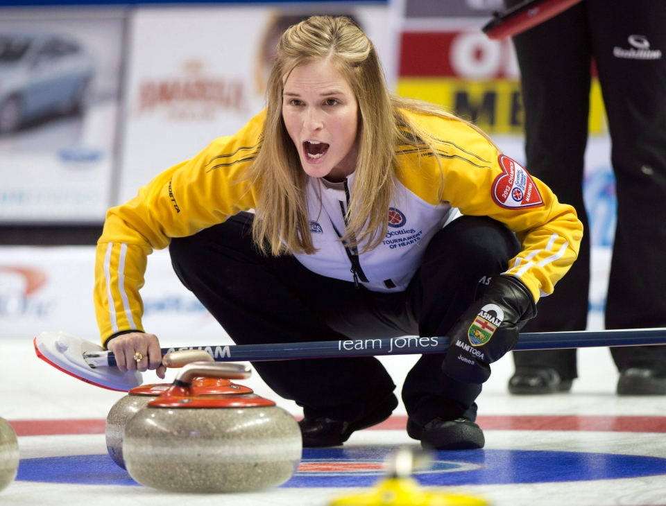 Manitoba skip Jennifer Jones takes a shot during the page playoff curling action against Ontario at the Scotties Tournament of Hearts Saturday, February 23, 2013 in Kingston, Ont. (THE CANADIAN PRESS/Ryan Remiorz)