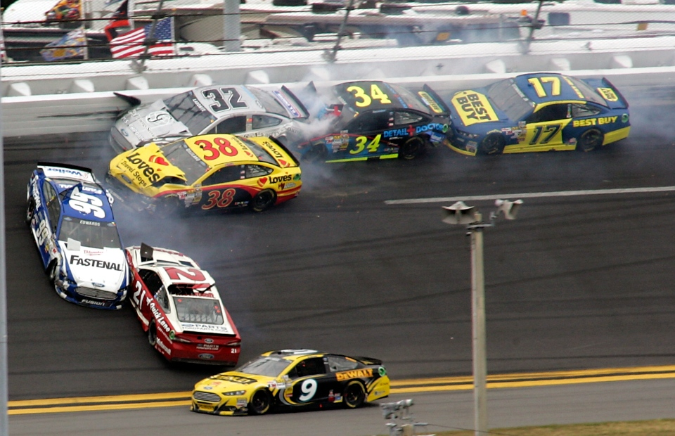 Carl Edwards (99) and Trevor Bayne (21) go sideways during a multi-car crash including David Gilliland (38), Terry Labonte (32), David Ragan (34) and Ricky Stenhouse Jr., (17) during the NASCAR Daytona 500 Sprint Cup Series auto race at Daytona International Speedway in Daytona Beach, Fla., on Sunday, Feb. 24, 2013.  (AP / Jim Topper)