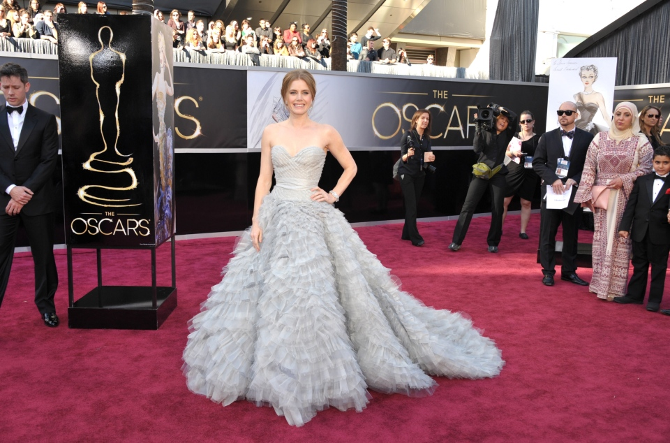 Amy Adams arrives at the 85th Academy Awards at the Dolby Theatre in Los Angeles on Sunday Feb. 24, 2013. (Invision / John Shearer)