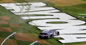 Jimmie Johnson celebrates after winning the Daytona 500 NASCAR Sprint Cup Series auto race, Sunday, Feb. 24, 2013, at Daytona International Speedway in Daytona Beach, Fla. (AP Photo/David Graham)