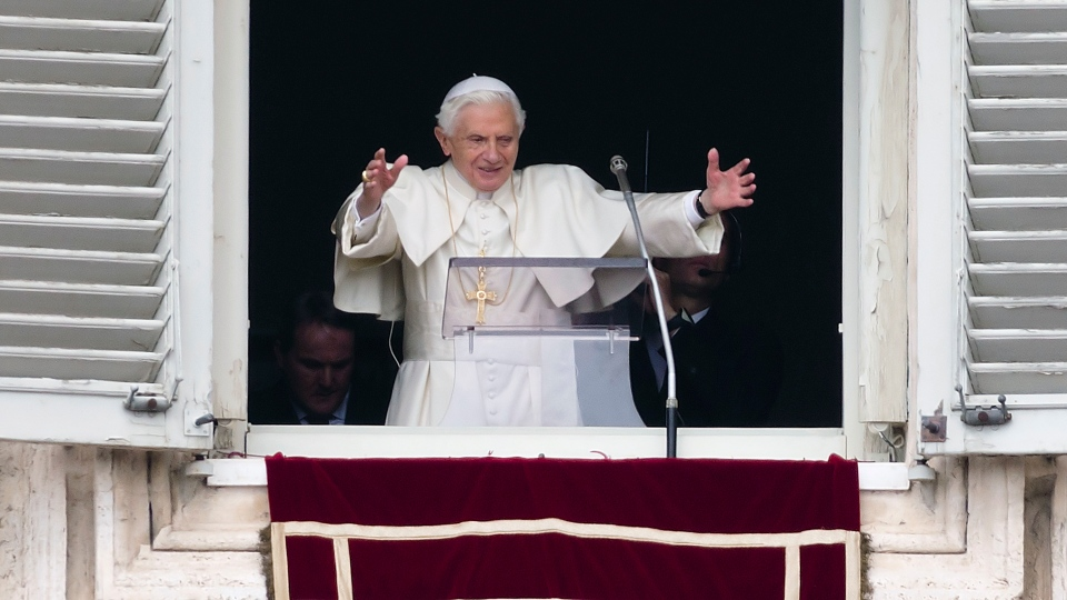 Pope Benedict XVI delivers his blessing during his last Angelus noon prayer, from the window of his studio overlooking St. Peter's Square, at the Vatican, Sunday, Feb. 24, 2013. (AP Photo / Andrew Medichini)