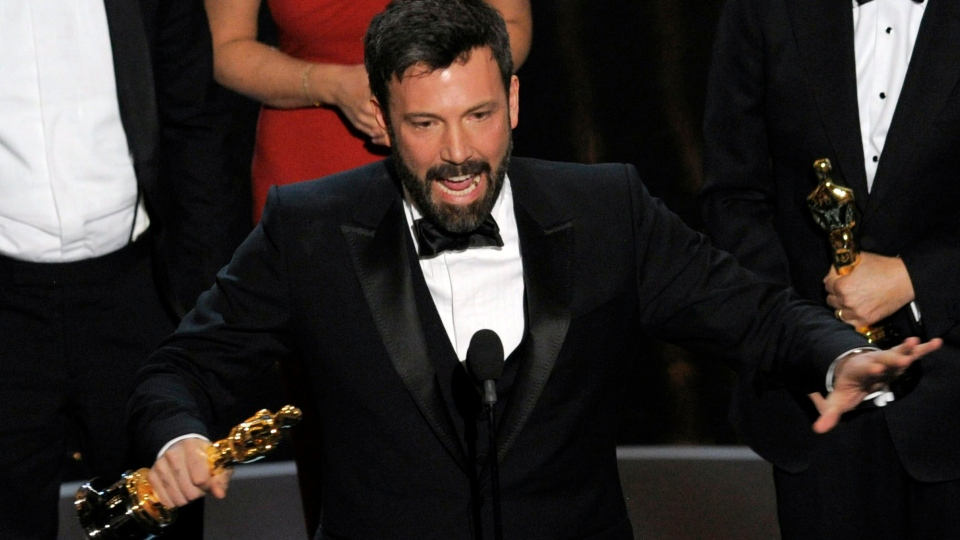 """Director/producer Ben Affleck accepts the award for best picture for """"Argo"""" during the Oscars at the Dolby Theatre on Sunday Feb. 24, 2013, in Los Angeles. (Photo by Chris Pizzello / Invision / AP)"""