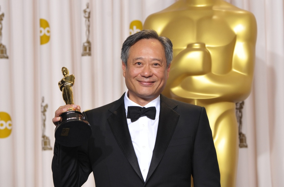 "Ang Lee poses with his award for best directing for ""Life of Pi"" during the Oscars at the Dolby Theatre on Sunday Feb. 24, 2013, in Los Angeles. (AP/Invision/ John Shearer)"