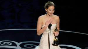 Jennifer Lawrence accepts the award for best actress in a leading role for 'Silver Linings Playbook' during the Oscars at the Dolby Theatre  in Los Angeles on Sunday Feb. 24, 2013. (Chris Pizzello / Invision)