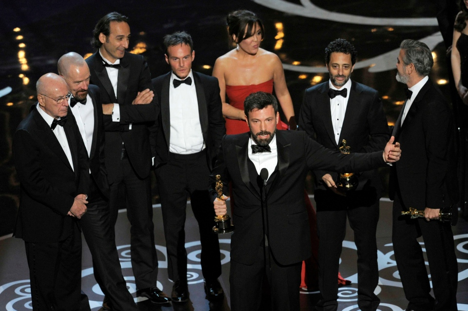 "Director/producer Ben Affleck, center, accepts the award for best picture for ""Argo"" as the cast and crew look on during the Oscars at the Dolby Theatre on Sunday Feb. 24, 2013, in Los Angeles. (Photo by Chris Pizzello/Invision/AP)"