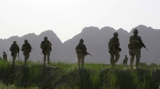 Canadian soldiers patrol