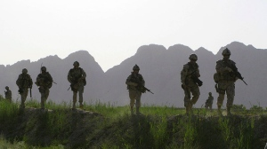Soldiers patrol an area in the Dand district of southern Afghanistan on Sunday, June 7, 2009. (Colin Perkel / THE CANADIAN PRESS)