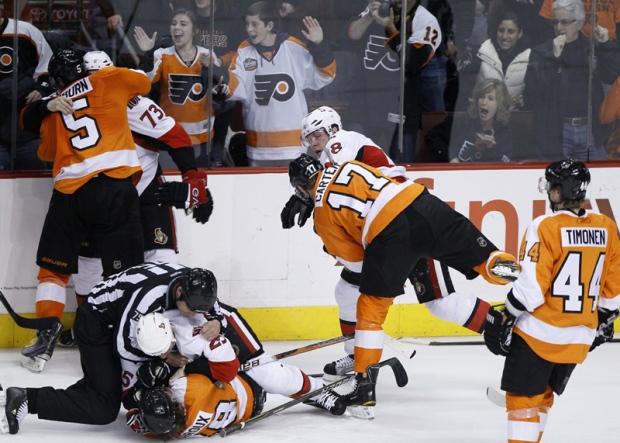 Philadelphia Flyers Braydon Coburn (5), Claude Giroux (28), Jeff Carter (17) and Kimmo Timonen (44), of Finland, fight with Ottawa Senators' Jarkko Ruutu (73), of Finland, Chris Neil (25) and Jesse Winchester (18) fight during the third period of an NHL hockey game, Thursday, Jan. 20, 2011, in Philadelphia. The Flyers won 6-2. (AP Photo/Matt Slocum)