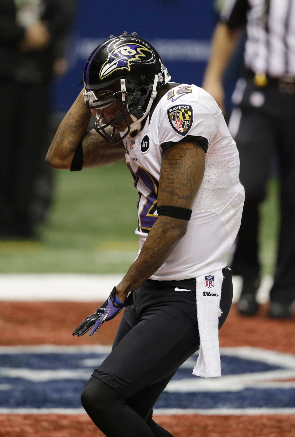 In this Feb. 2, 2013 file photo, Baltimore Ravens wide receiver Jacoby Jones (12) dances after scoring a touchdown against the San Francisco 49ers in Super Bowl XLVII in New Orleans. (AP Photo/Elaine Thompson, File)
