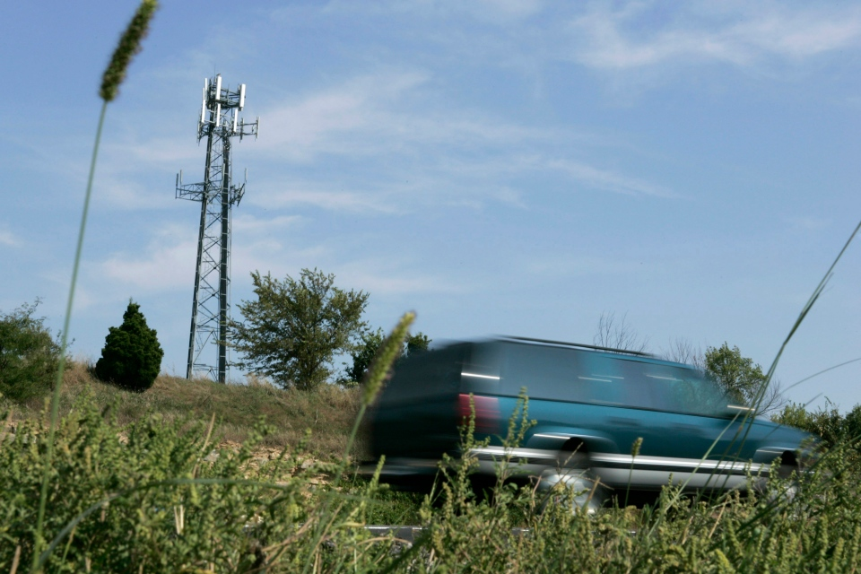 In this file photo taken Sept. 21, 2007, traffic passes a cellular tower along a stretch of Interstate 470 north of Lee's Summit, Mo. (AP Photo/Dick Whipple, File)