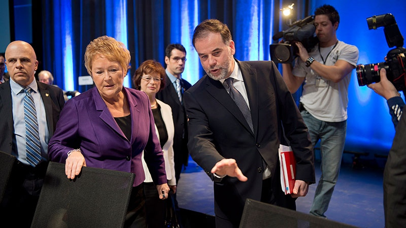 Quebec Premier Pauline Marois (left) and Education Minister Pierre Duchesne arrive at the education summit in Montreal on Monday, Feb. 25, 2013. (Paul Chiasson / THE CANADIAN PRESS)