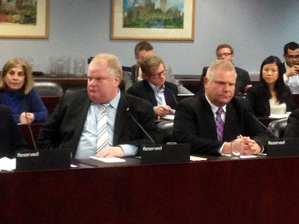 Toronto Mayor Rob Ford sits next to his brother Doug Ford during an audit hearing into his 2010 campaign finances at city hall in Toronto on Monday, Feb. 25, 2013. (Byron Auburn / CTV Toronto)