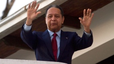Former dictator Jean-Claude 'Baby Doc' Duvalier waves to supporters from the balcony of a rented guest house where he is staying in Port-au-Prince, Haiti, Friday Jan. 21, 2011. (AP / Ramon Espinosa)