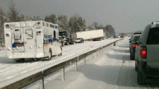 An ambulance arrives at the scene of a multi-car pile-up on Highway 11 between Barrie and Orillia, Ont., on Friday Jan. 21, 2010, in this photo by Industry Minister Tony Clement. (THE CANADIAN PRESS / Tony Clement)