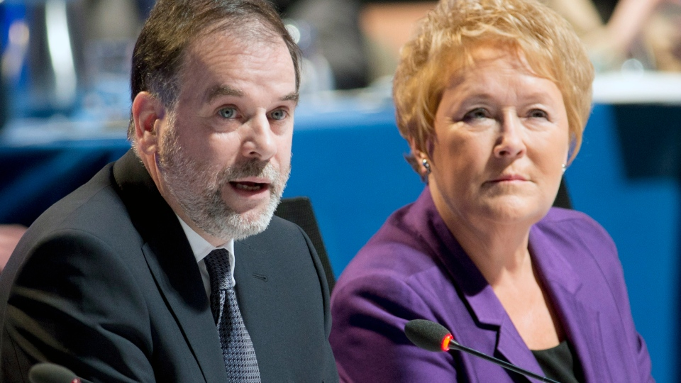 Quebec Premier Pauline Marois, right, listens to Education Minister Pierre Duchesne deliver opening remarks at the education summit in Montreal on Monday, Feb. 25, 2013. (Paul Chiasson / THE CANADIAN PRESS)