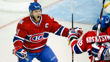 Montreal Canadiens' Sako Koivu, from Finland, left, celebrates with Andrei Kostitsyn, of B�larus, after Kostytsyn scores the first goal against the Boston Bruins during first period of game four NHL playoff hockey action in Montreal Wednesday, April 22, 2009. THE CANADIAN PRESS/Ryan Remiorz