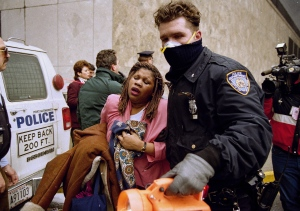 In this Feb. 26, 1993, file photo, a New York City police officer leads a woman to safety following a bomb blast at the World Trade Center. (AP Photo/Alex Brandon, File)